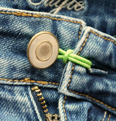 Extend the waistband of your tight pants using a hair tie