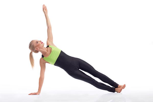 9. Plank with arm raise