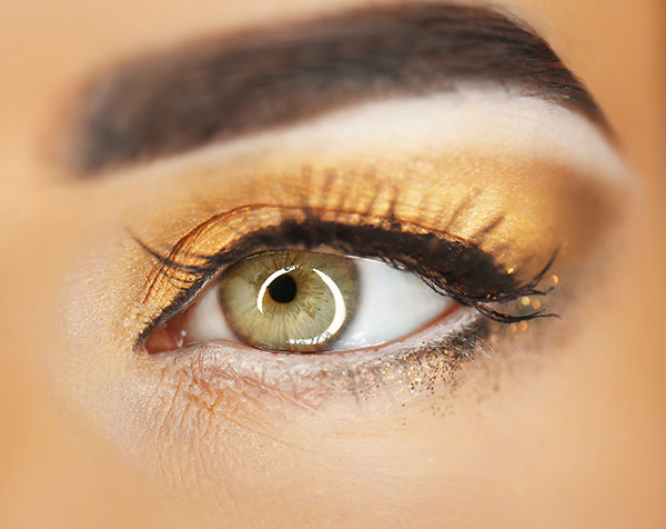 use of gold shimmer eye shadow