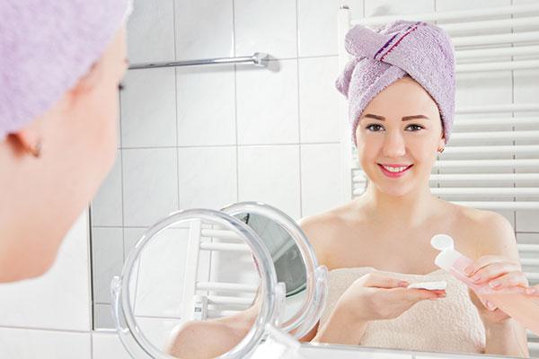 Women Applying Skin Toner
